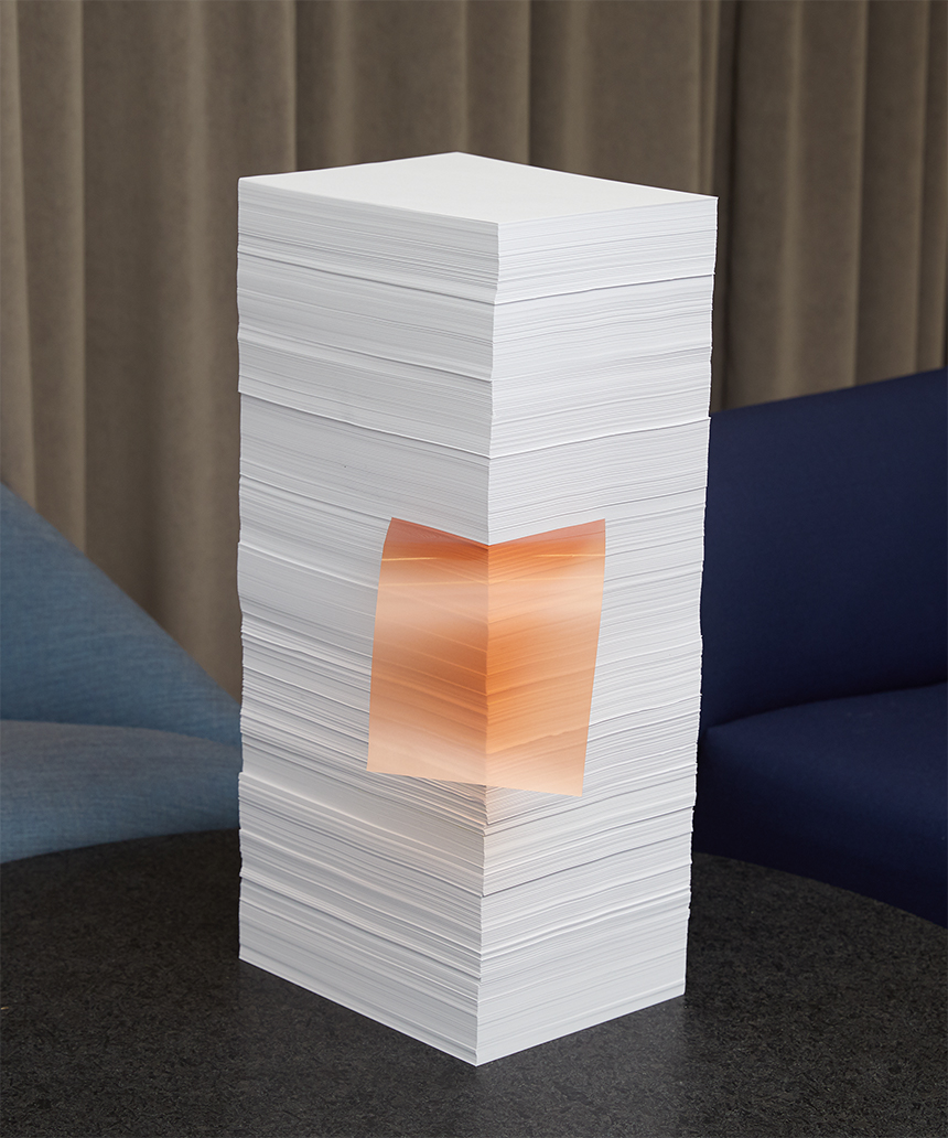 A stack of papers on a modern coffee table