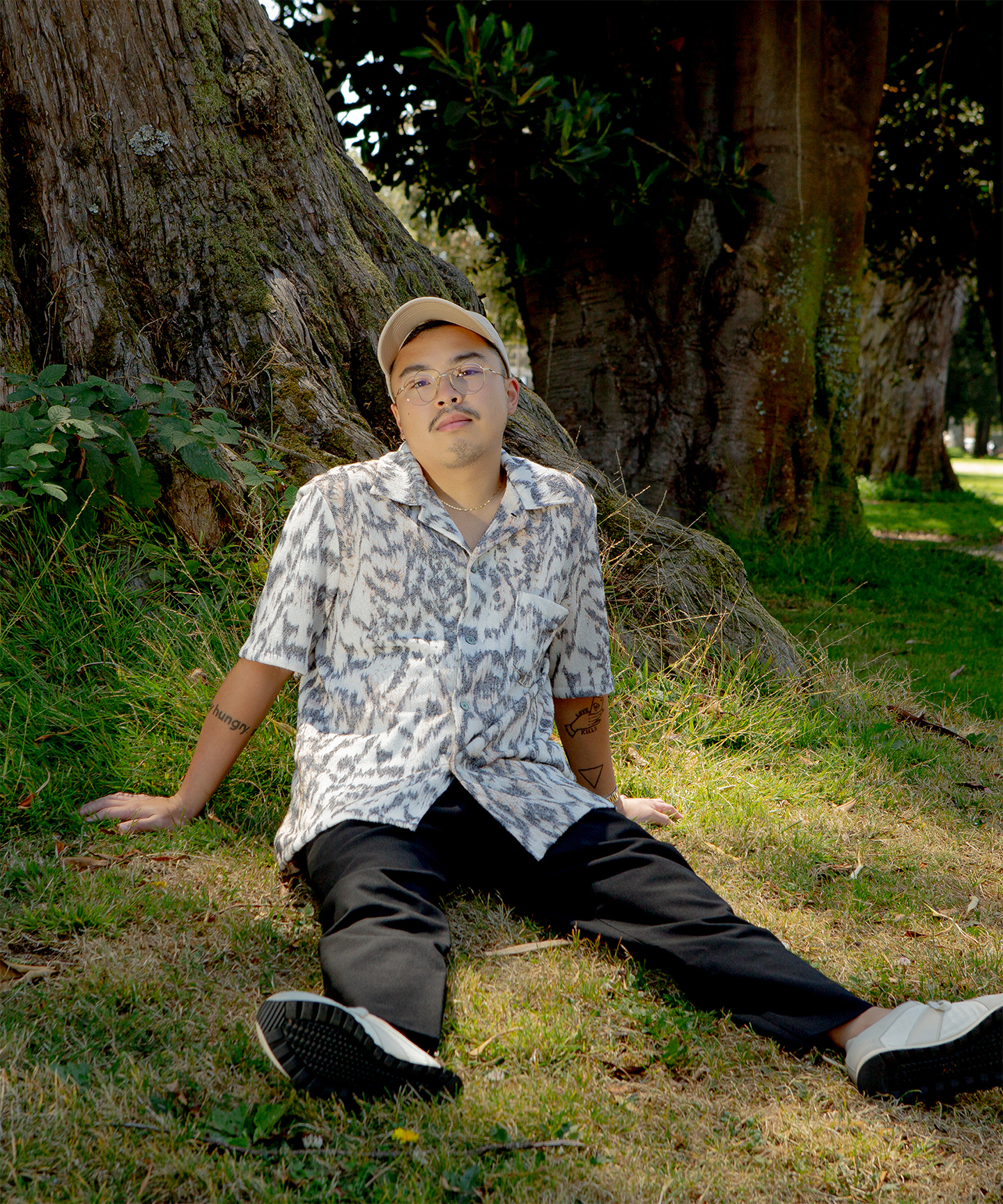 Kris Mendoza sitting on grass