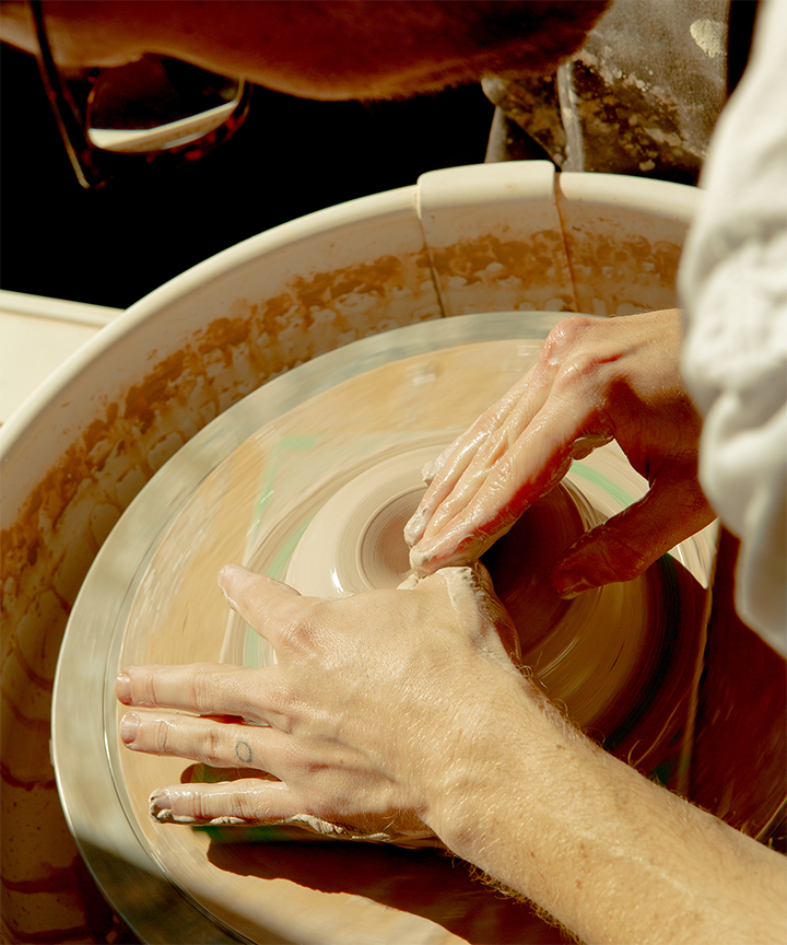 close up of Alex's hands on the pottery wheel