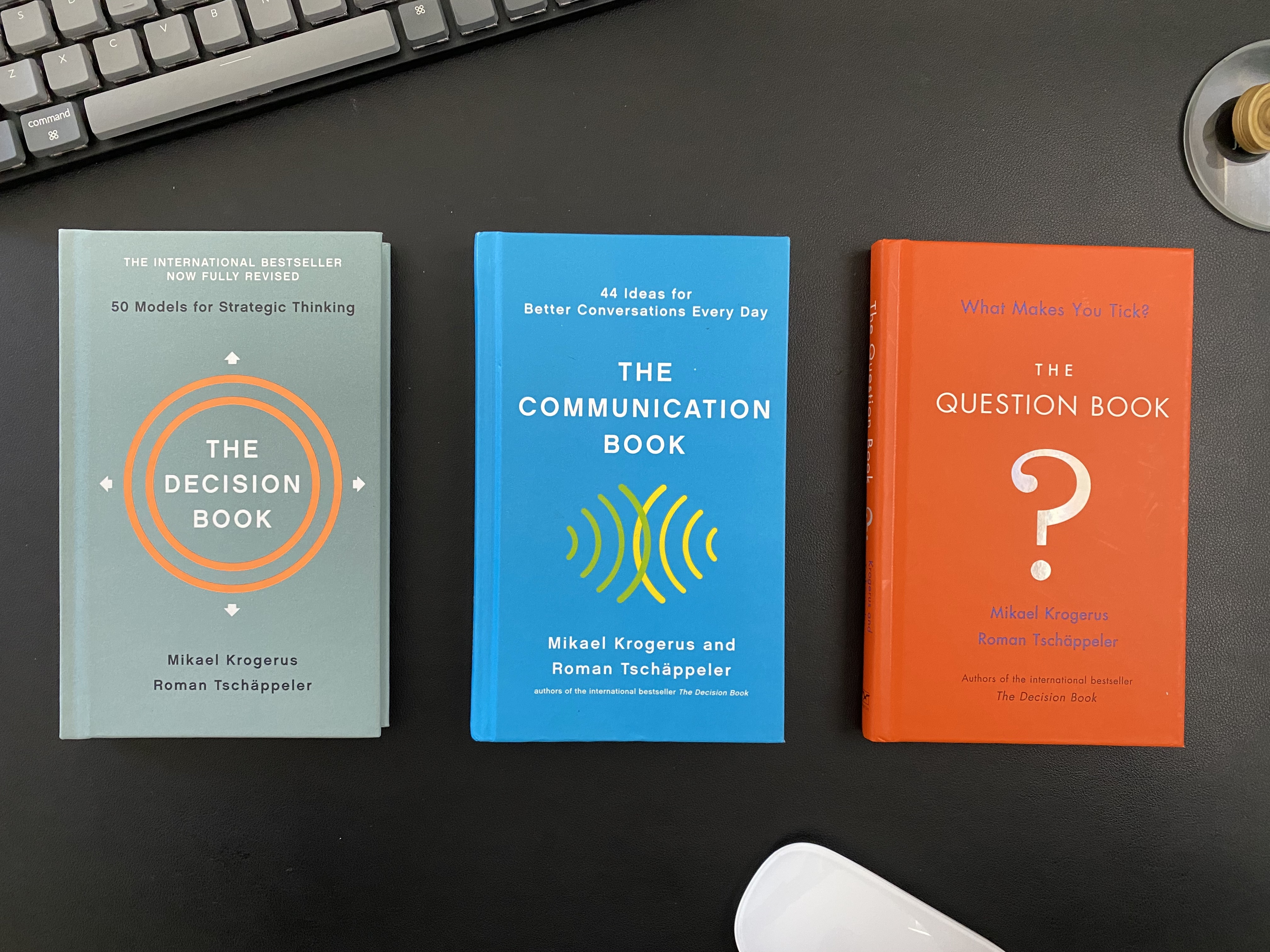 Image of three books: The Decision Book. The Communication Book. The Question Book.