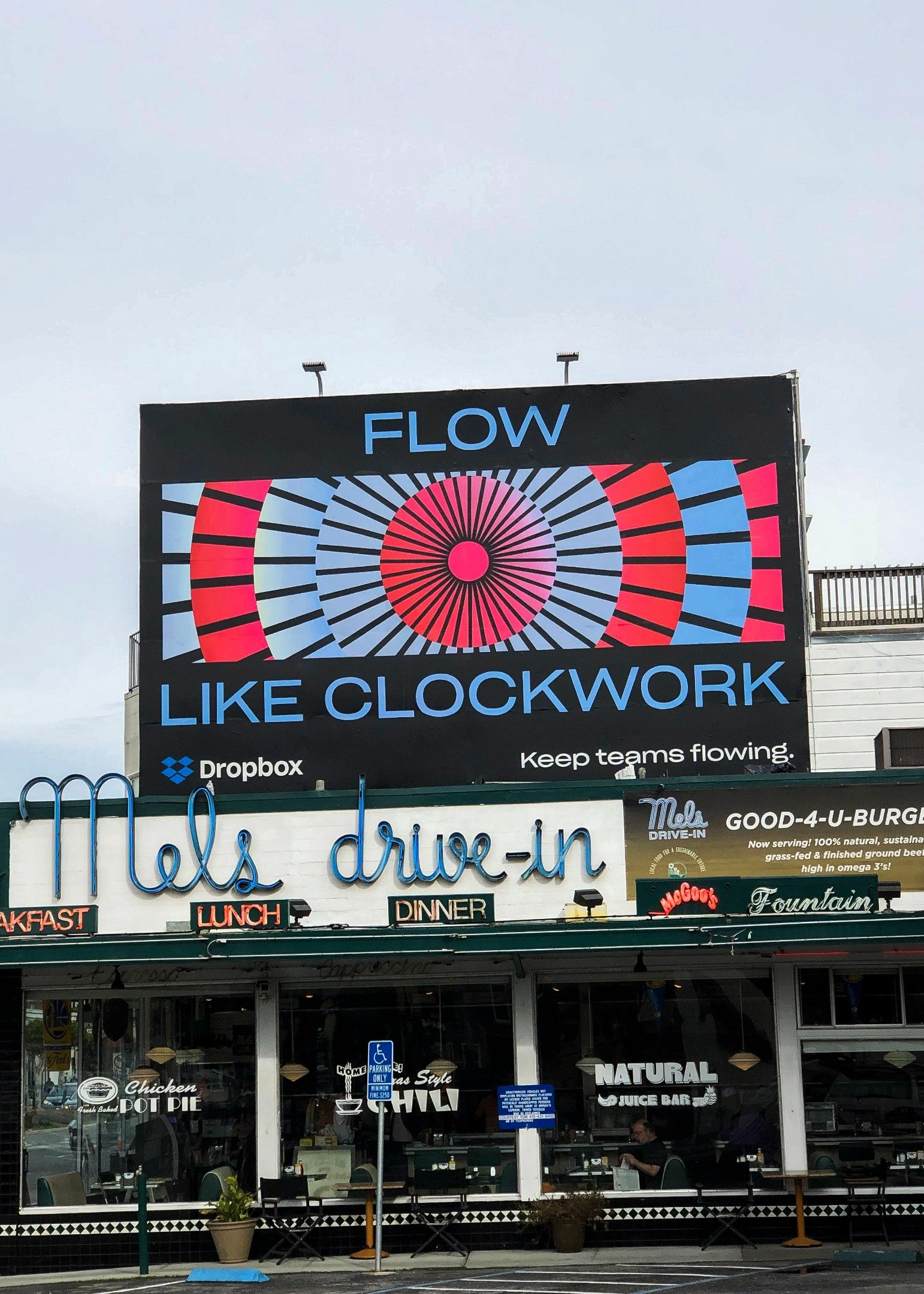 "A billboard for the ""Flow"" campaign hung brightly above Mel's Drive-in Diner in San Francisco, California."