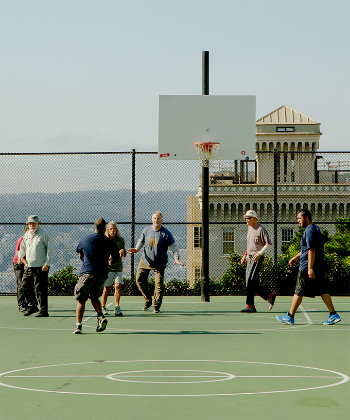 Basketball field with people playing