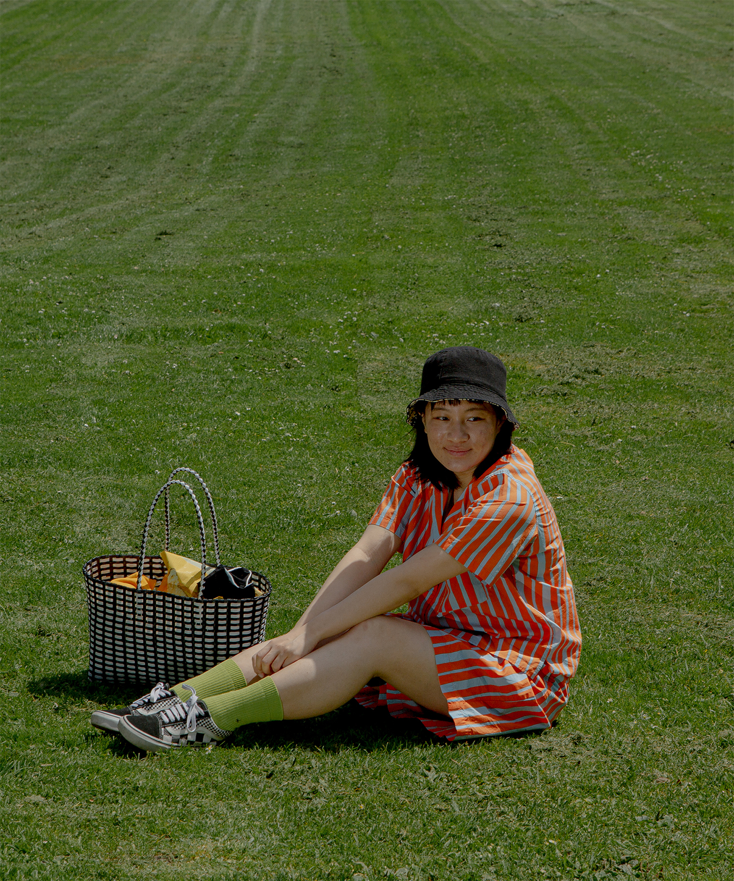 Fanny Luor sitting on grass