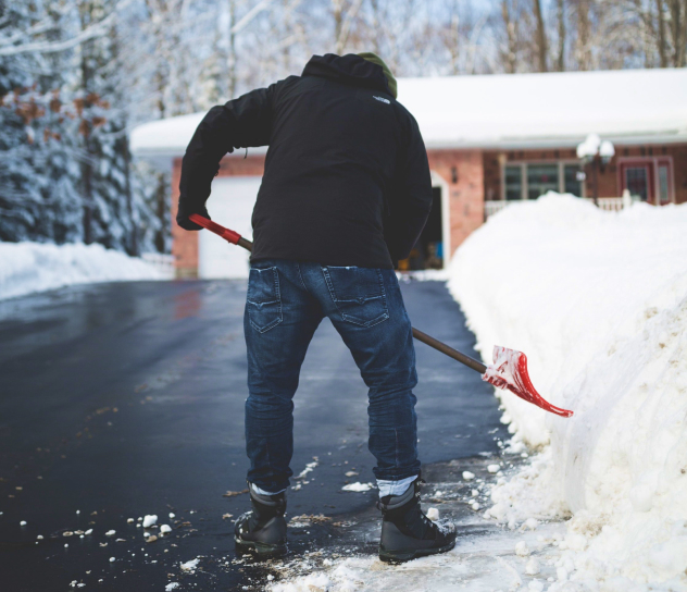 Image of a man shovelling snow.
