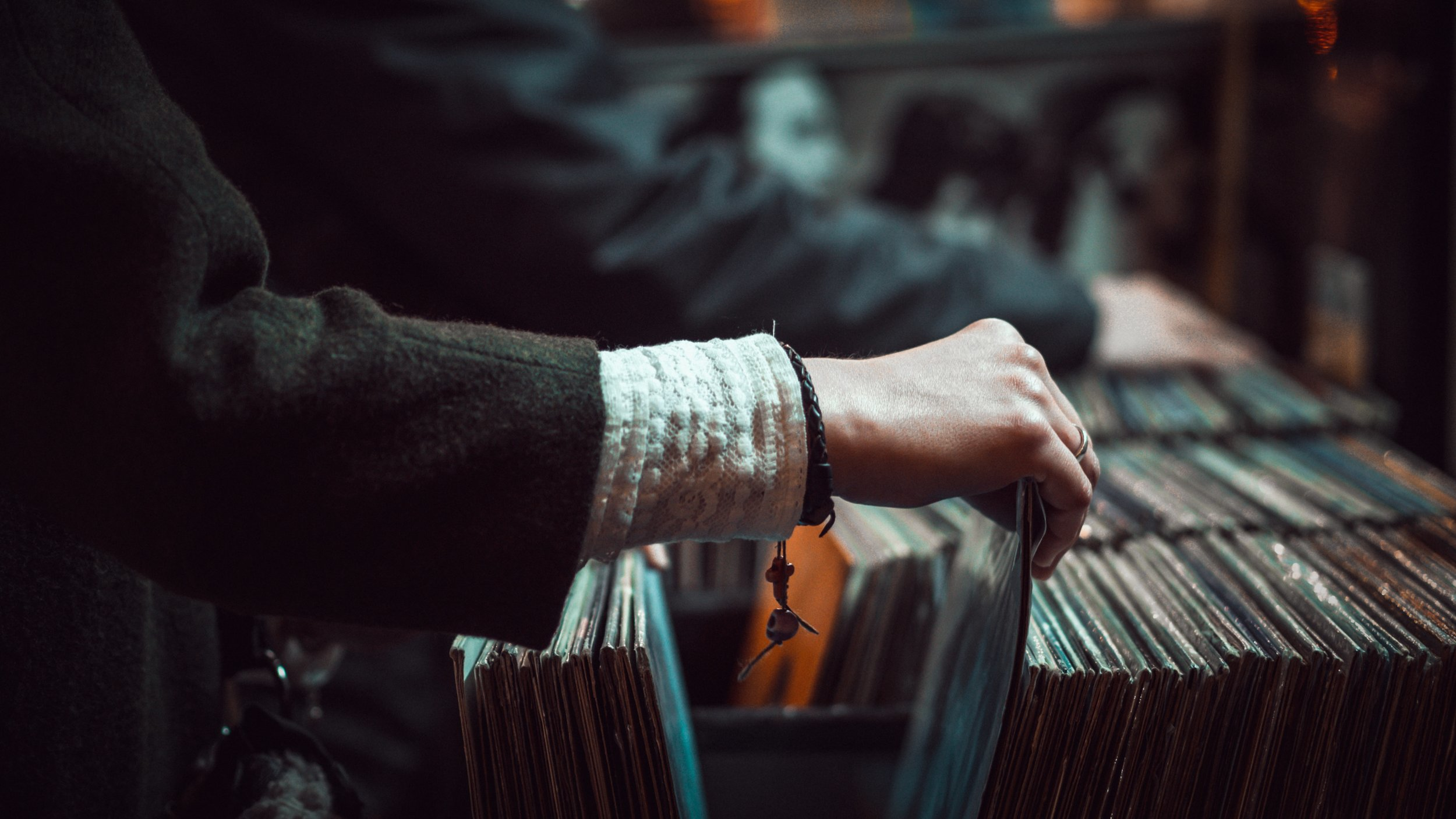 Person browsing LP records