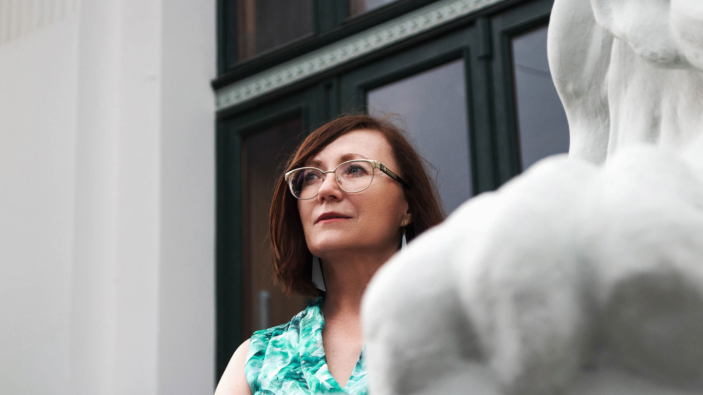 Woman with glasses looking straight ahead