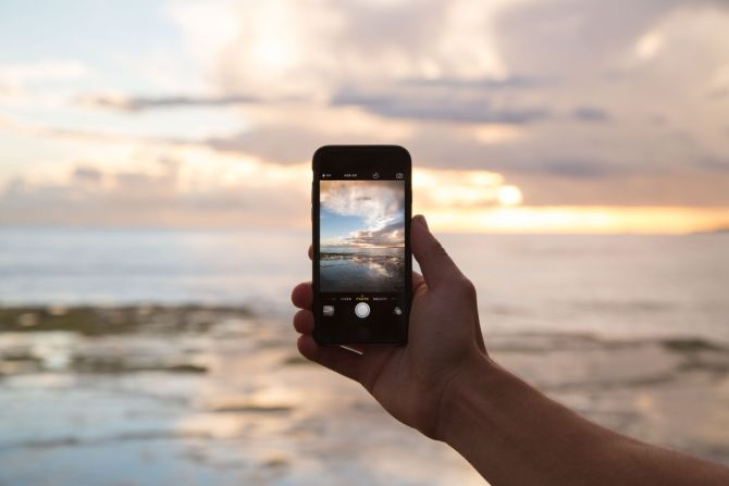 Mobile phone taking a picture of the sea
