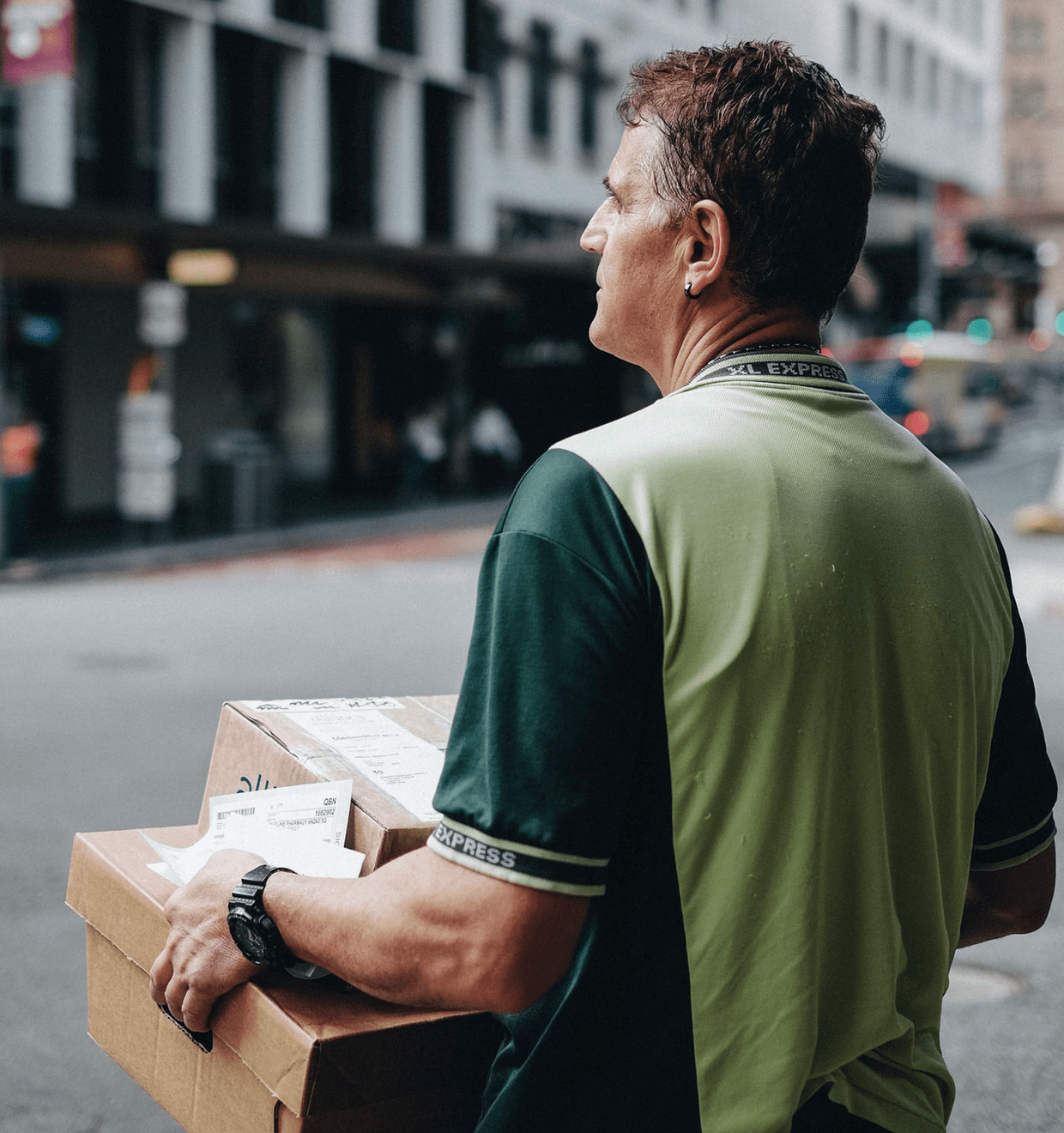Photo of a delivery man carrying two packages