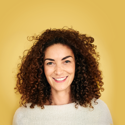 woman-curly-hair-yellow-background 2