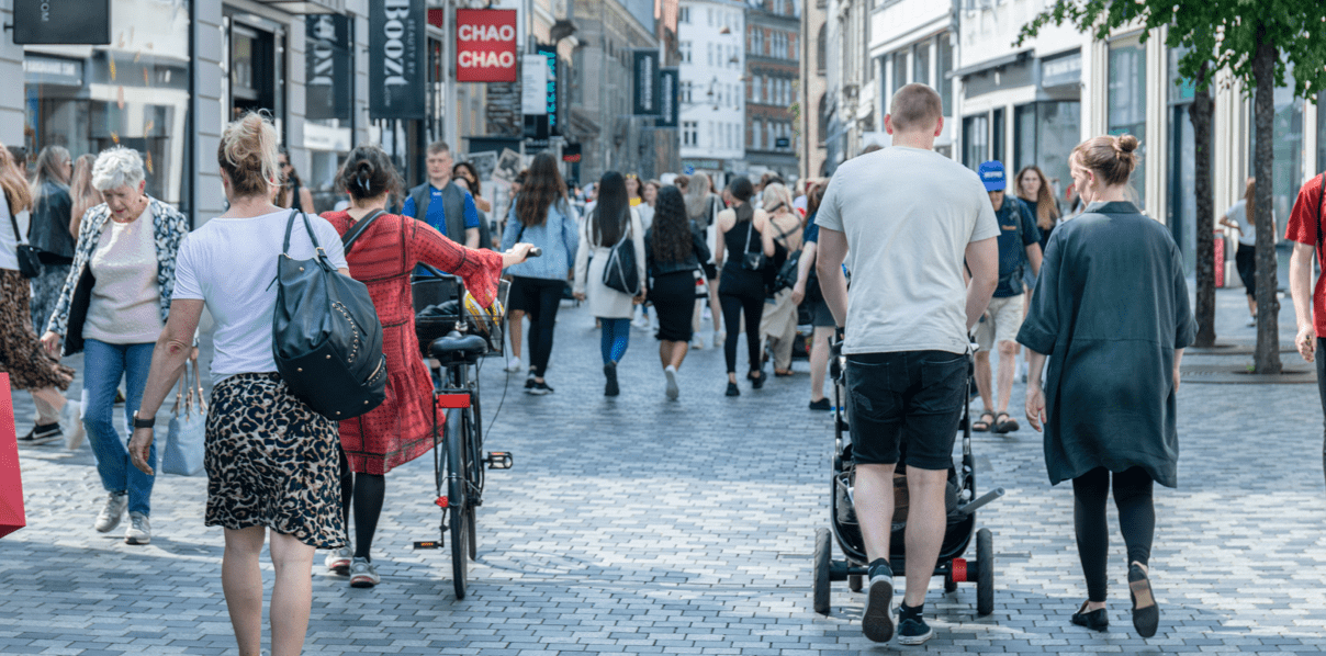 Photo of a busy shopping street in Copenhagen with many people walking