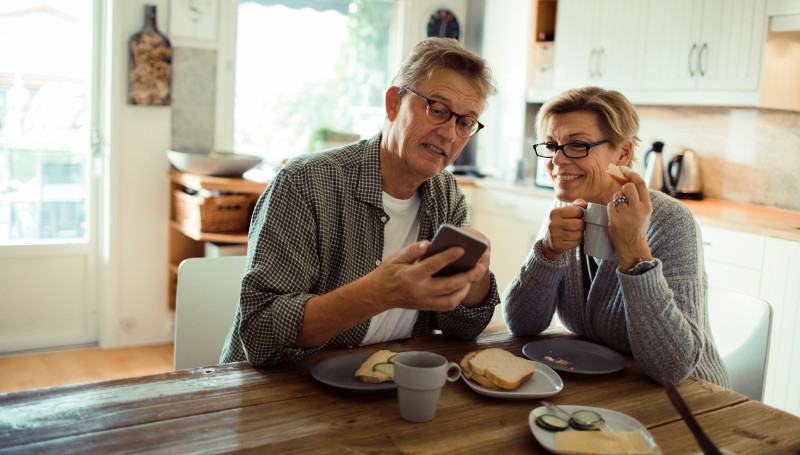 Older couple looking at mobile phone