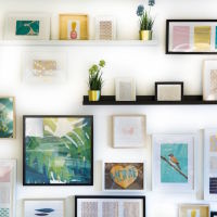A colourful wall of stylish paintings in the home thumbnail