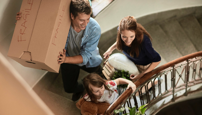 Family carrying things up a staircase