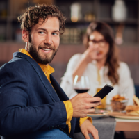Man smiling with mobile phone thumbnail