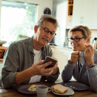 Older couple looking at mobile phone Thumb
