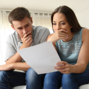 Worried couple looking at document Thumb