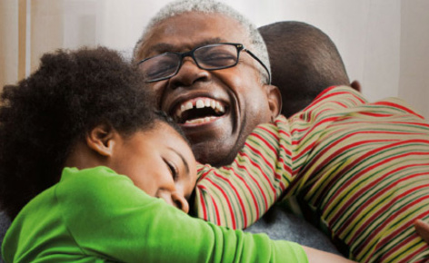 Grandparent hugging kids