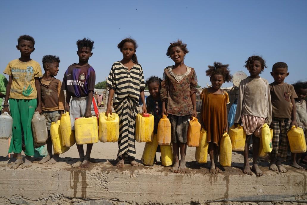 Children wait for clean water