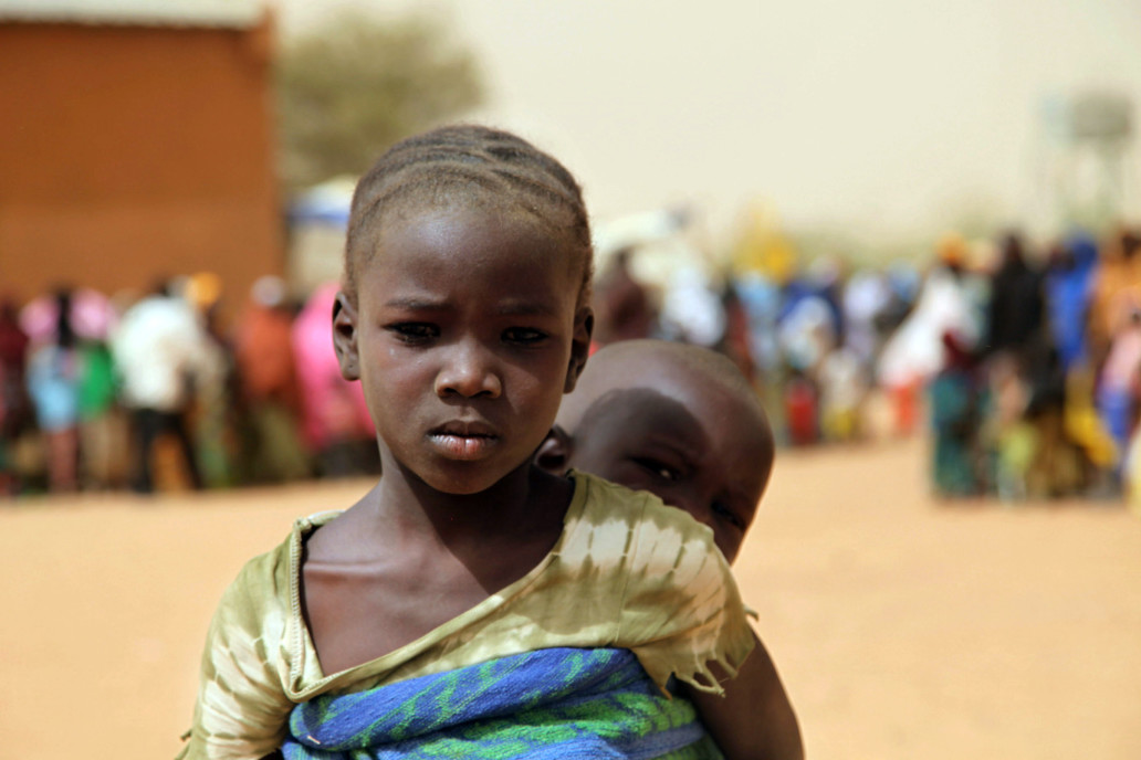 Girl in displaced crowd