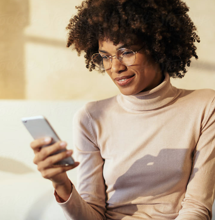 Photo of woman in glasses looking at her smartphone
