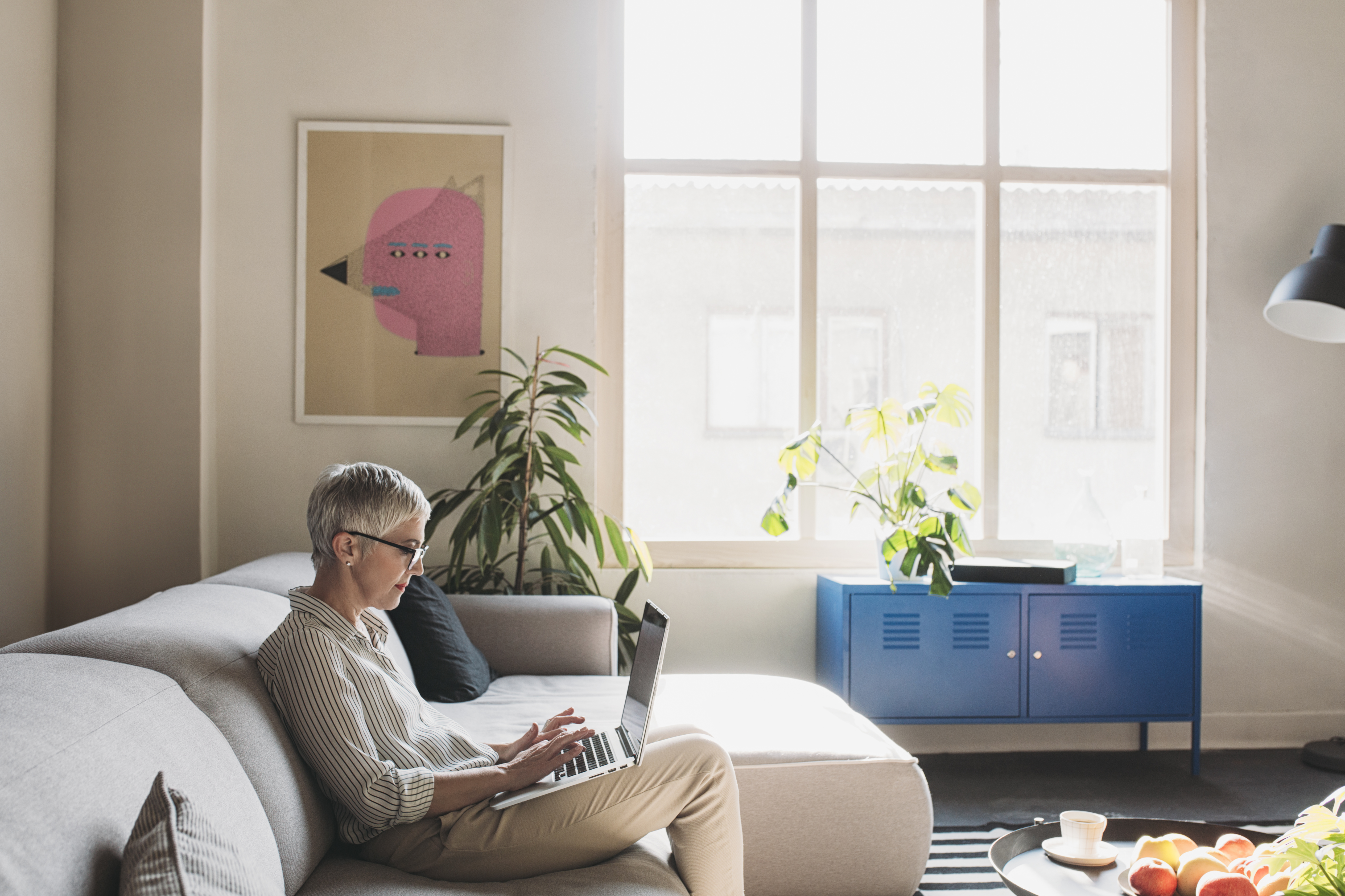 Photo of woman on computer on couch