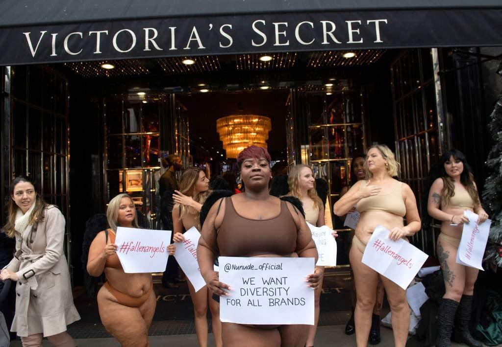 women-strip-down-to-their-underwear-to-protest-outside-victorias-secret-store-in-london