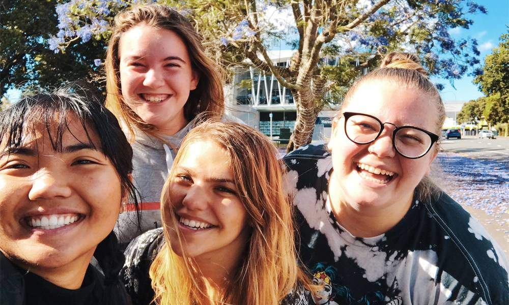 Group of very happy teens smiling
