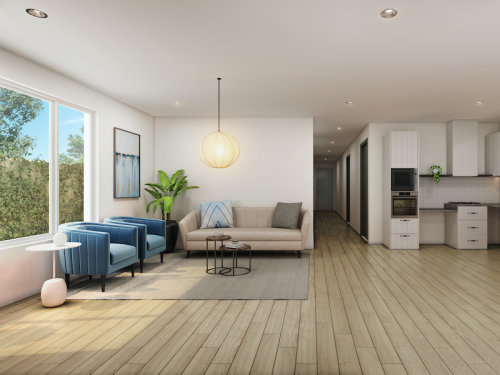 Spacious open plan living room and kitchen separated by hallway down the middle.