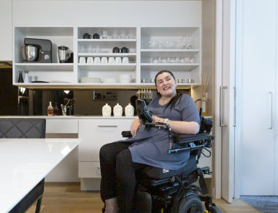 person in an accessible kitchen in an SDA home
