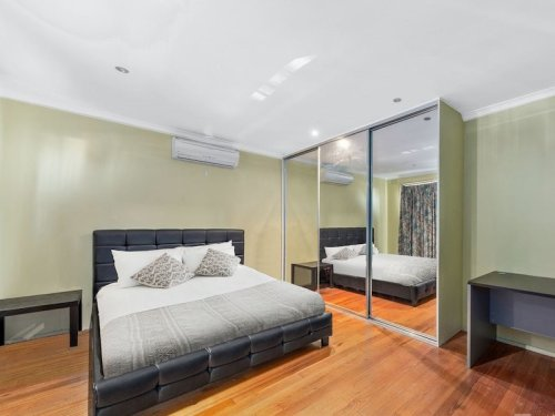 picture of the property bedroom, floor to ceiling mirrors and double bed