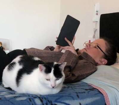 Belinda reading a book with her cat
