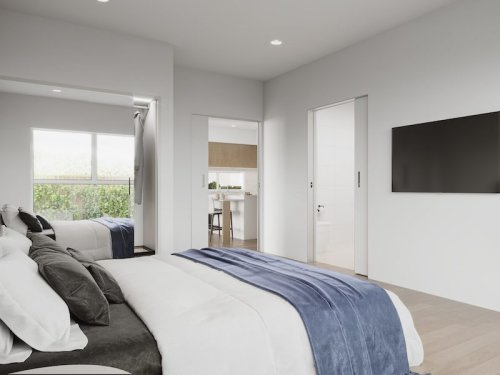 an accessible bedroom connected to the bathroom and living area