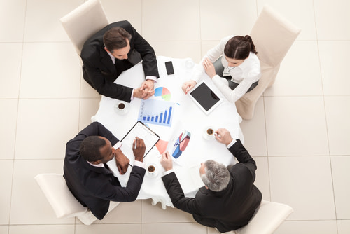 A business meeting at a round table.