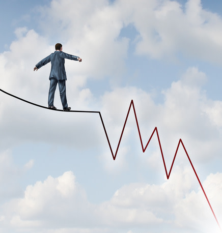 Man tight rope walking on stock chart