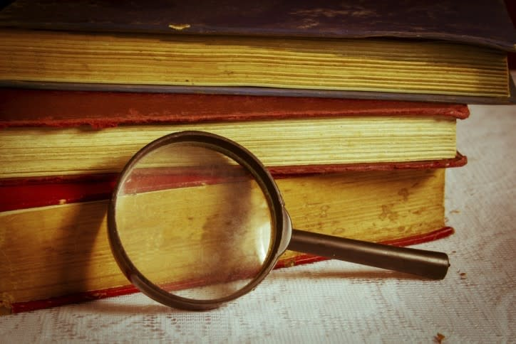 Magnifying glass on library book.