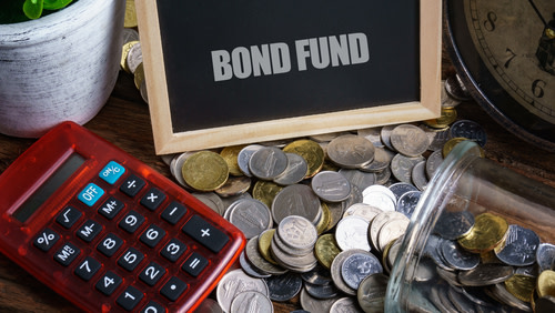 Bond funds, coins, red calculator.