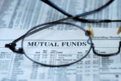 Glasses on Top of Mutual Funds Newspaper