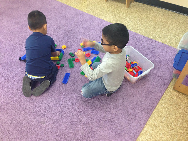 Pre k boys playing with lego