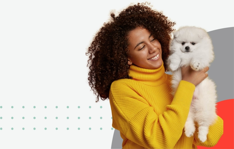 Woman holding a white poodle
