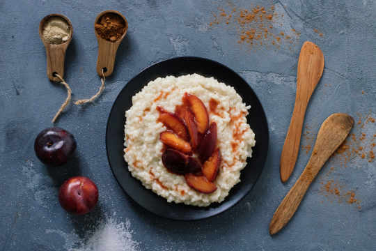 Vegan rice pudding with plum compote