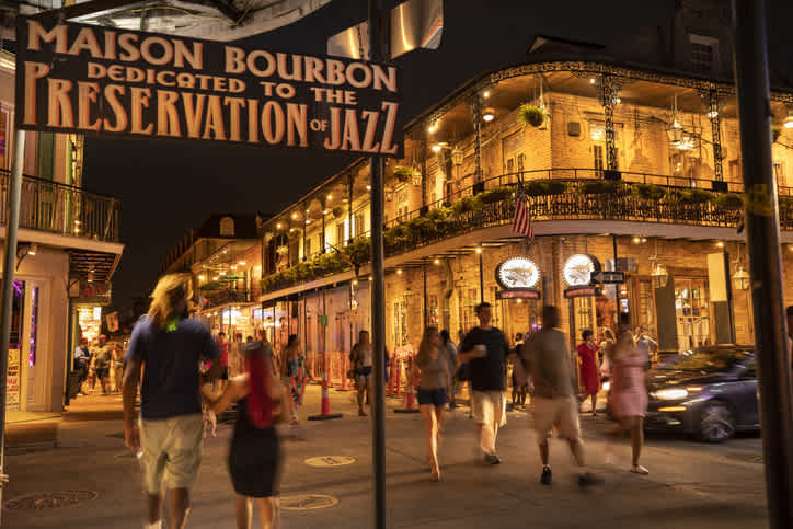 Passers-by stroll past the famous Preservation Hall Jazz Bar in the French Quarter on Bourbon Street, one of the most popular places to visit during your trip to Louisiana.