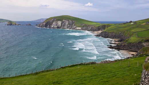 A beach in Cork surrounded by pastoral landscapes - discover more on a tour of Ireland.