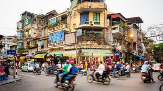 One_with_motor scooters_lively_crossing_in_Hanoi_Vietnam