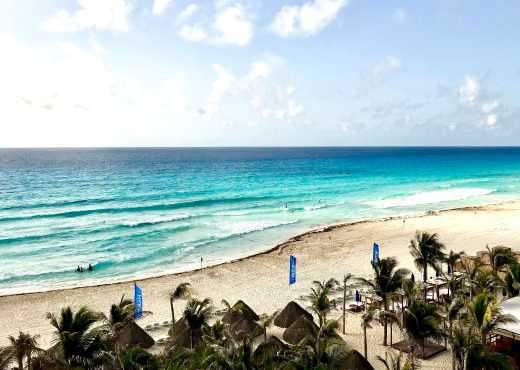 Experience white stalls on a Cancun vacation