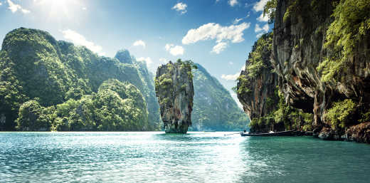 Asia, Thailand, Phang nga national park, Koh tapu rises from turquoise waters.
