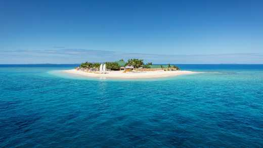 South Pacific Islands, Fiji,  view of Mamanuca Island from offshore surrounded by peaceful waters.