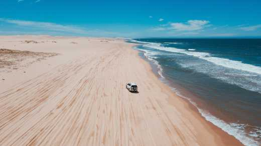 Oceania, Australia, car driving down a beach