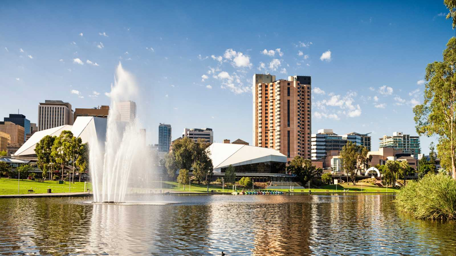 Oceania, Australia, a fountain with the Adelaide skyline in the background with blue skies.