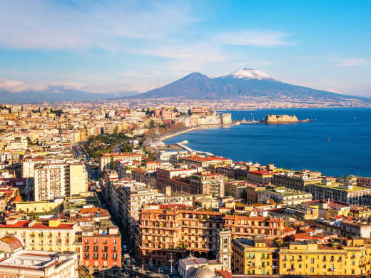 See Naples from above Naples, with the unusually snowy Vesuvius volcano in the background, on a Naples vacation