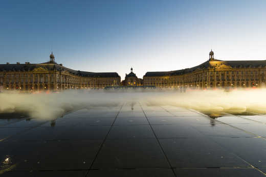 Visit the Place de la Bourse, pictured here under blue sky, on a Bordeaux vacation